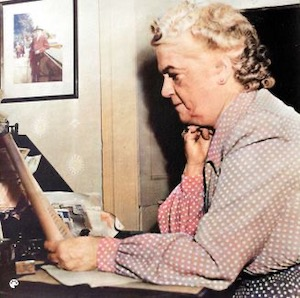 Colorized Emilie Loring at her desk