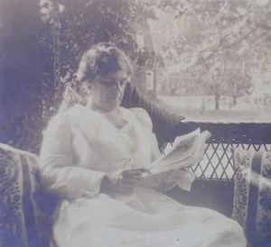 Emilie reading on her porch (1)